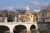 It's a romantic idea to walk along the streets that line the River Tevere.